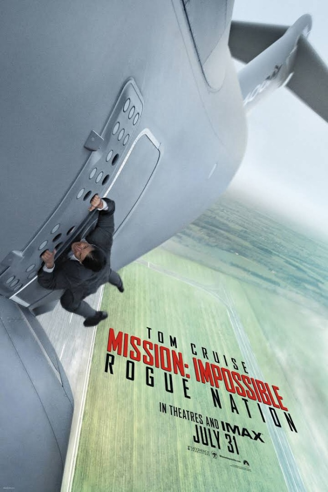 Tom Cruise hangs off the side of a plane
