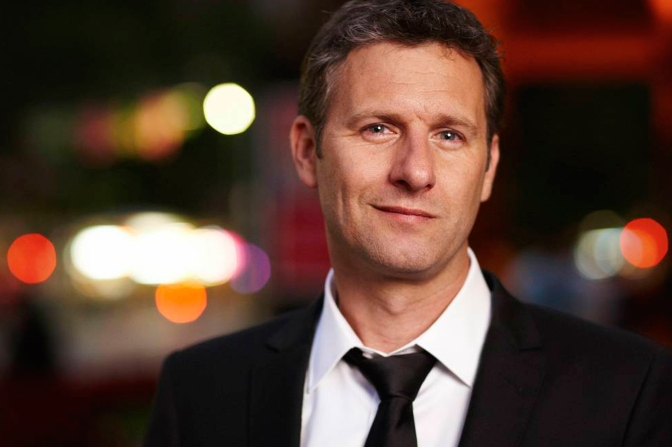 Adam Hills signs book deal