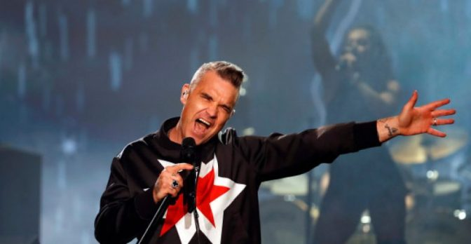 Robbie Williams writing a song for new Brit flick